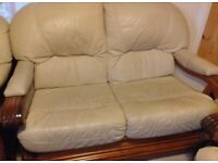 Cream leather 3 piece suite with decorative wooden frame
