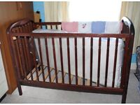 A child's drop side cot, with new mattress.