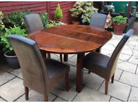 Excellent. Indian Hardwood Extending Dining Table And Chairs.