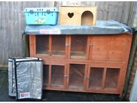 Two-storey rabbit hutch with waterproof & thermal protectors, carry case, run, & rabbit equipment