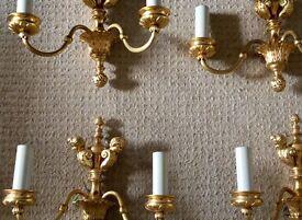 Ornate gold wall lights