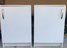 Two White Storage Cupboards with internal shelving.