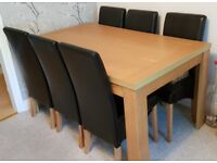 Argos oak effect dining table and 6 black chairs
