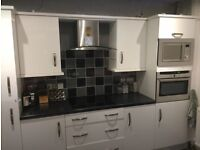 High gloss white Kitchen units with hob and hood