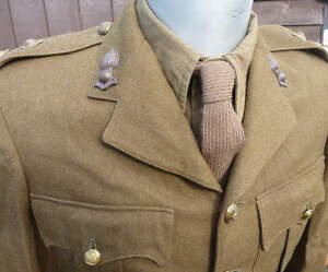 BRITISH ARMY NECK TIE (WW2 OFFICERS/OR's BATTLEDRESS or S.D. TUNIC). NEW ON ROLL