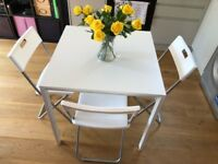 Dining table with it's 3 chairs for £60