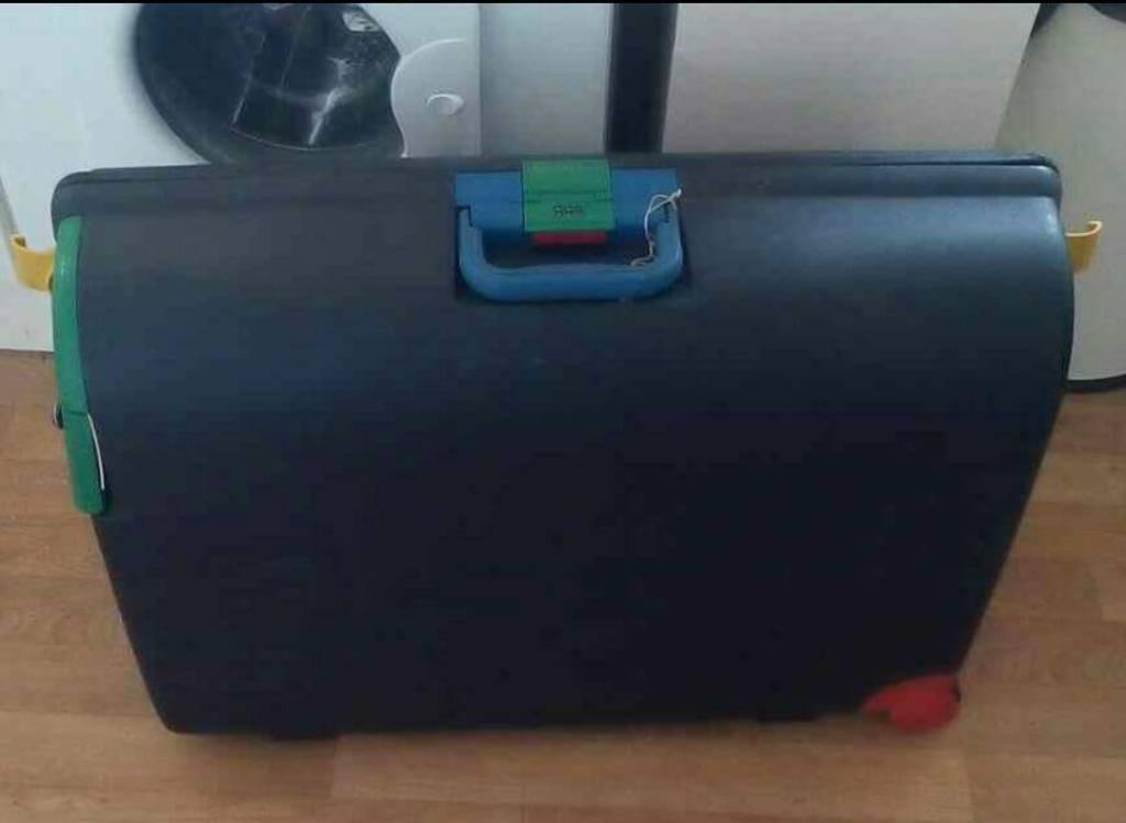 Large hard suitcase.