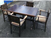 A VINTAGE/ANTIQUE ERCOL DRAW LEAF DINING TABLE AND FOUR ERCOL CARVER DINING CHAIRS