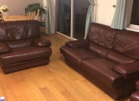 burgendy designer leather sofa and 2 armchairs (can be sold separately)