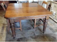 Solid oak antique dining table.