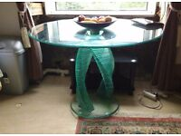 Circular glass dining table