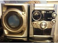 Panasonic stereo system with 5 speakers.
