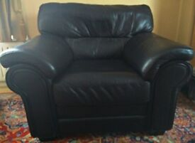Single soft black leather sofa available for collection.