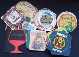 LOT OF 40+ BEER/WHISKY OLD COASTERS/TABLE MATS.VINTAGE.£ 5.00.Collectables