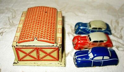 "Early Penny Toys, Marked ""Made in Germany"" 3 Tin Cars and one Tin Garage"