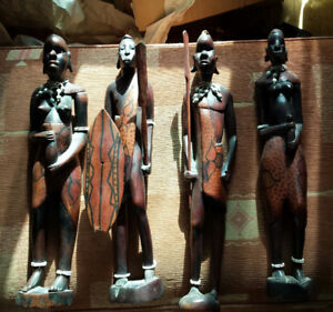 carved wooden masai figures