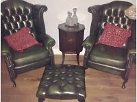 Two green chesterfield arm chairs and foot rest
