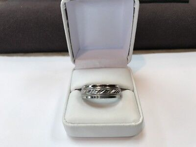 MEN'S WEDDING BAND OF STAINLESS STEEL IN A SIZE ELEVEN AND ONE HALF (11.5)
