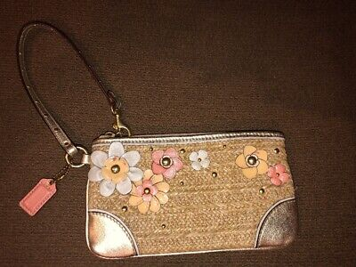 Wicker Accents - Coach wicker wristlet with flower detail and gold accents