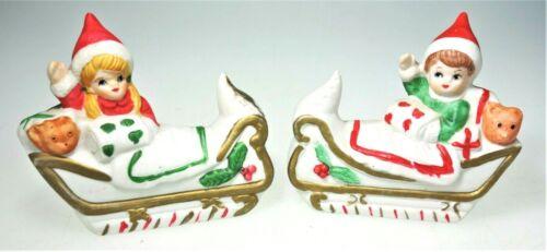 Flambro Porcelain Figurines Boy Girl Sleigh Bed Vtg Christmas Holiday Bisque Elf