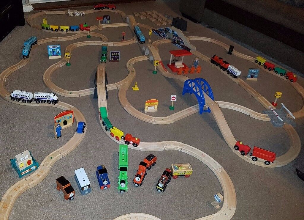 Wooden train track + 37 trains and carriages + extras