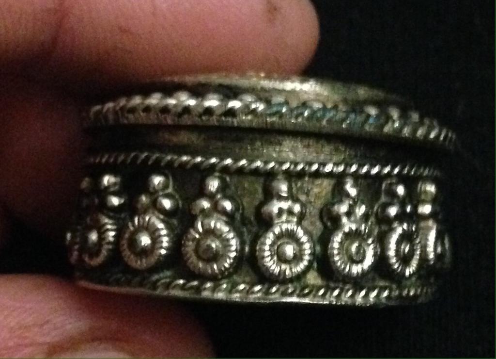 Silver coloured small tin.