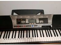 Yamaha PSR 350, with music stand, keyboard stand, power adaptor and floppy disk