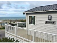 New 2 bedroom luxury twin unit lodge including full decking and 2017 site fees in west Wales