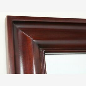 Brand new mahogany full sized mirror in its original packaging