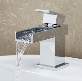 Nearly new basin and waterfall tap