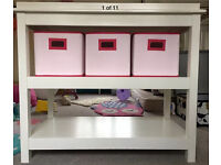 Little White Company Changing Table and pink boxes