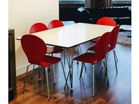 Modern dining table and set of 6 chairs
