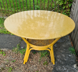 Large round wicker dining table