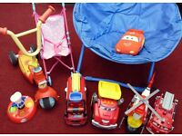 Round blue chair, 5 toy cars, scooter, dolls pushchair
