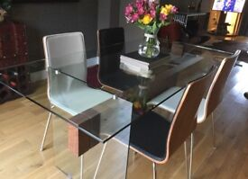 Treble Glass dining table with 4 Walnut backed chairs