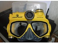 Snorkelling Mask 5mp snap shot/video camera, 1gb micro SD card, 2 batteries and USB cable.