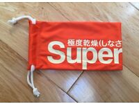 BRAND NEW Superdry Glasses Sunglasses Drawstring Pouch Cleaning Cloth (Orange)