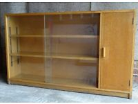 Oak bookcase and cabinet with with sliding glass doors