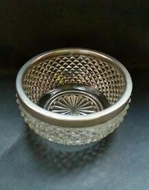 Cut glass bowl with silver plated edge
