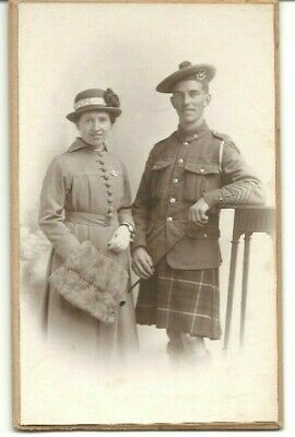 WWI postcard unidentified member of the Seaforth Highlanders & Sweetheart on car