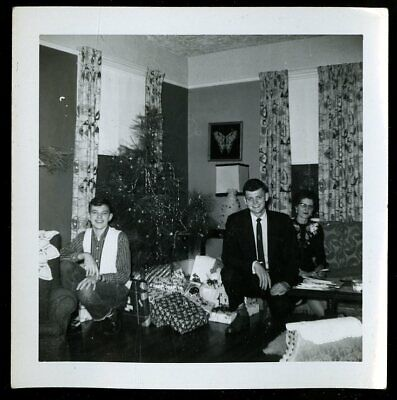 Vintage Christmas Photo FAMILY SITS ON FLOOR IN FRONT OF CHRISTMAS PRESENTS  ()