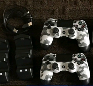 Two used (like new) PS4 Controller WITH charging stand!