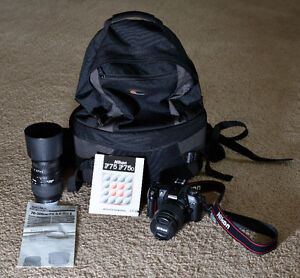 Nikon F75 with 2 lens and camera back pack.