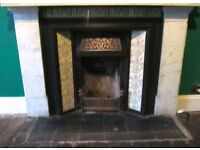Victorian Cast Iron Fireplace Insert with patterned green tiles and fender