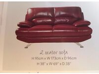 Nearly New Claret Leather 2 seater Settee comtemporary style very good condition