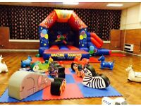 Childrens bouncy castle with slide and Soft Play
