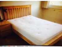 Lovely solid wood double bed with mattress for sale