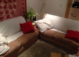 Two comfy used fabric sofas - £40 for the pair