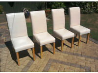 Set of 4 Cream Leather/light oak legs dining chairs. As new condition.