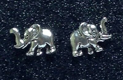 Sterling Silver Elephant with Tusks design Post / Stud Earrings. 1 matched (Elephant Design Earrings)